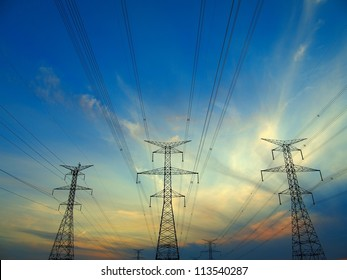 Electric post in a field and blue sky