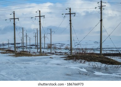 Electric Posts in snowy landscape in Russia