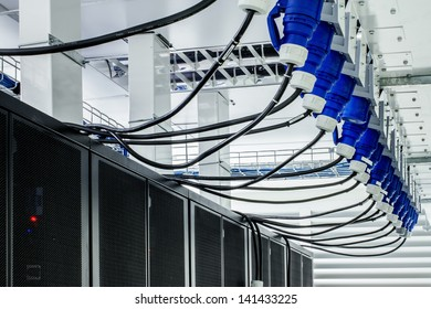 Electric power cable for Server computer in modern interior of data center.