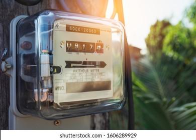 Electric power meter measuring power usage. Watt hour electric meter measurement tool with copy space.