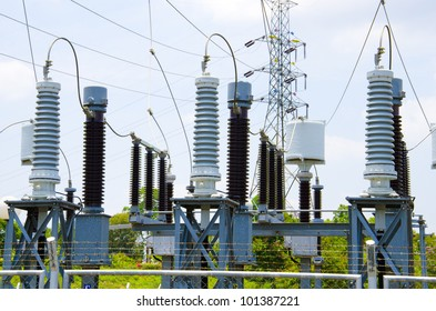 Electric power station in blue cloudy sky