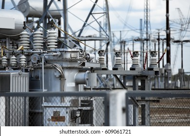 Electric power transmission lines. High voltage switchgear and equipment in front of power plant.