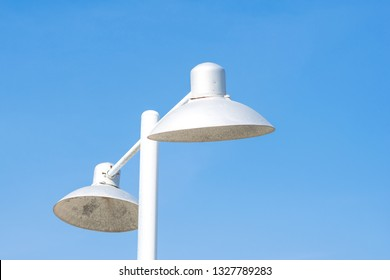 electric public street lamp posts with bluesky