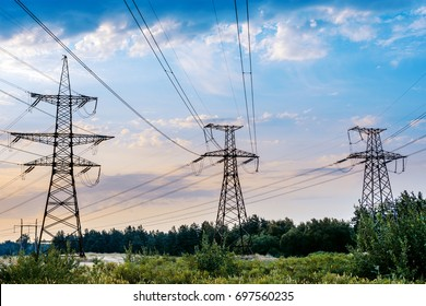 The electric pylon in the rice field with the blue sky. Energy distribution concept.