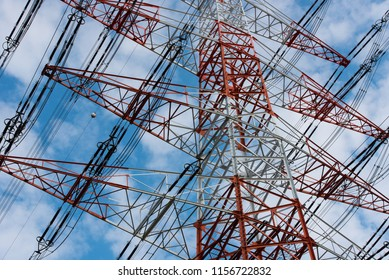 Electric pylons against blue sky