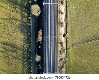 Electric railway crossing winter countryside landscape aerial photo