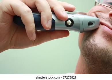 Electric razor man shaving