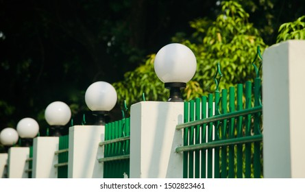 Electric round shape lights on a concrete exterior wall