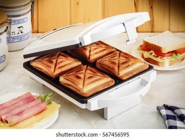 electric sandwich maker on kitchen board
