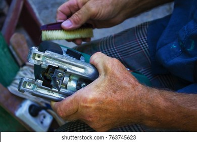 electric saw in the hands of a man