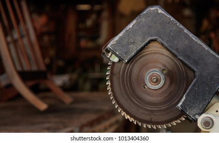 Electric saw from steel with circular jagged disc for woodwork. Blur backdrop, close up view, banner