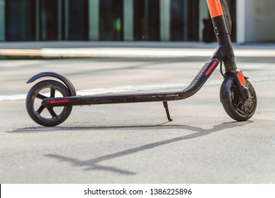 Electric scooter at cityscape background. Ecology transport concept.