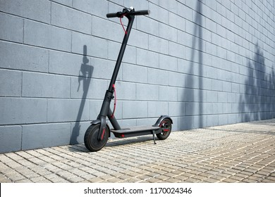 electric scooter near concrete wall