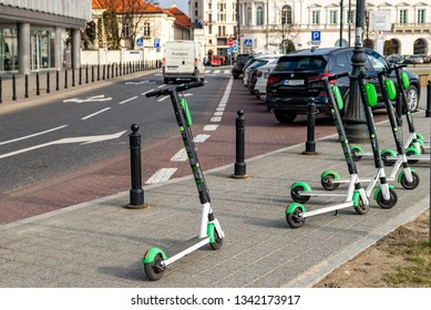 Electric scooter parked on the road. Warsaw Poland. February 18, 2019.