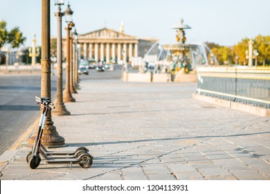 Electric scooters on the street near Concordia square during the morning light in Paris