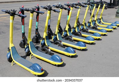 Electric scooters parked in a sharing station point