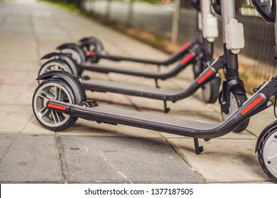 Electric scooters for rent. urban transport. Electric Ride Sharing Scooters Lined Up and Ready to Rent