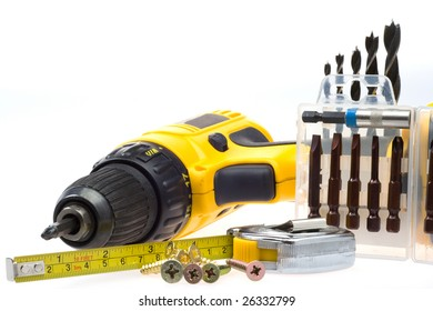 Electric screwdriver and accompanying equipment on a white background