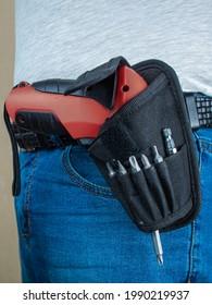 Electric screwdriver in a belt holster - Shutterstock ID 1990219937