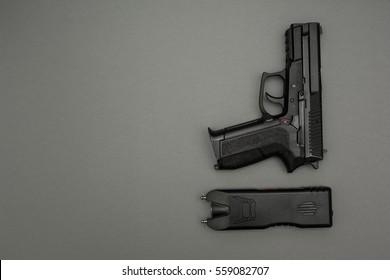 Electric shock machine and gun on grey background