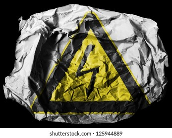 Electric shock sign painted on painted on crumpled paper on black background