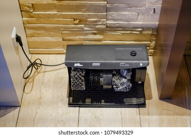 Electric Shoe Polisher or Automatic Shoe cleaning machine installed in home.