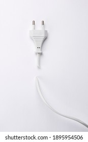 Electric socket with cut cable on white background.