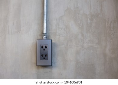 Electric socket for power  on concrete loft style wall