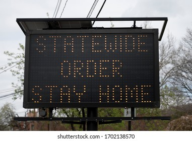 An electric STATEWIDE ORDER STAY HOME Sign related to Corona Virus pandemic.