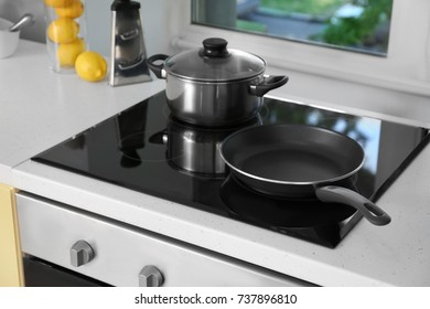 Electric Stove With Cooking Utensils In Kitchen