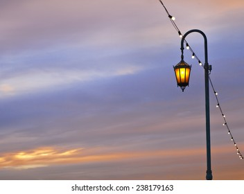 Electric Street lamp at a lake Merritt in Oakland, sky with clouds at the sunset