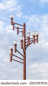 Electric street lights on blue sky background