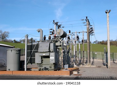 Electric sub power station in rural countryside with a blue sky to the rear.