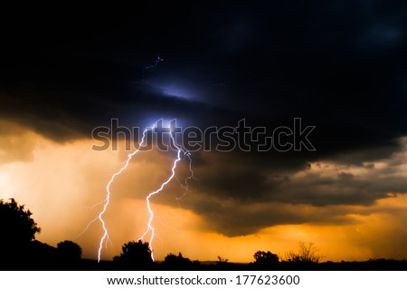 Electric Sun Set with lightning from clouds as the sun sets