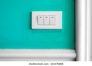 Electric switch on the blue wall.