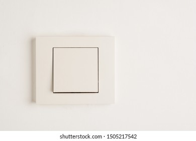 Electric switch with space for text on white wall