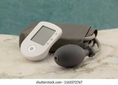 Electric tonometer. Semi-automatic or mechanical tonometer. Digital blood pressure monitor.