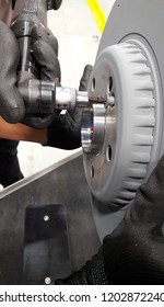 Electric tool tightening the bolt to lock in the brake disc for process assembly line.