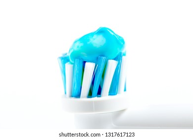 Electric toothbrush head with toothpaste closeup on isolated on white background