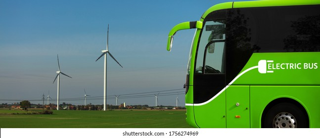 Electric tourist bus on a background of wind turbines
