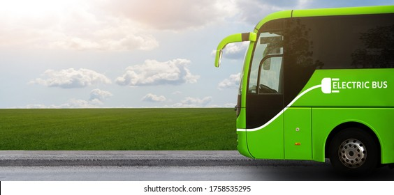 Electric tourist bus on a background of green field