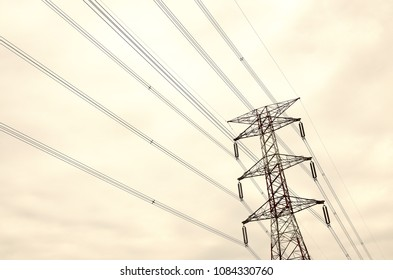 Electric tower with cloudy sky. Tone effected.