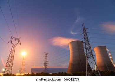 Electric tower and the cooling tower in the night sky blue background