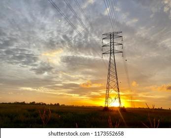 Electric tower with orange colour sunset
