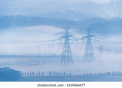 electric towers in the morning fog,  beautiful natural scenery and ultra-high voltage power transmission background