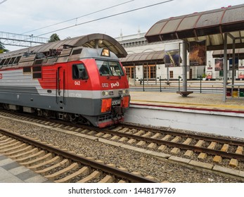 An electric train on the railway platform of the station Russia Sochi 06.22.2019