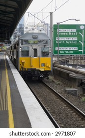 Electric train in Sydney, Australia arriving at train station