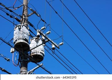 Electric transformer on blue sky