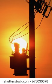 Electric Transformer with sunset background.