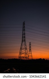 Electric transmission line during Twilight.electric pylon at sunset.high voltage post.